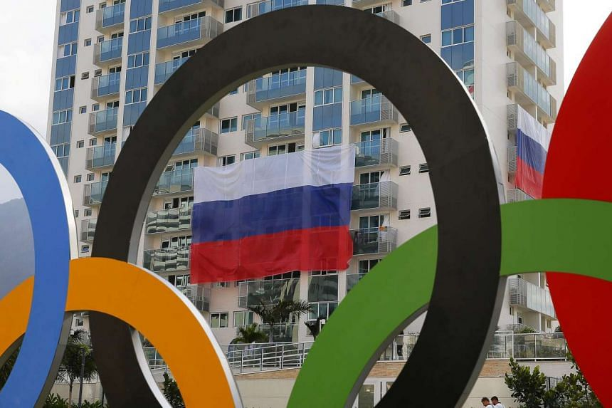 A Russian national flag hangs from the balconies of the Russia Olympic team building in the Olympic village prior to the Rio 2016 Olympic Games