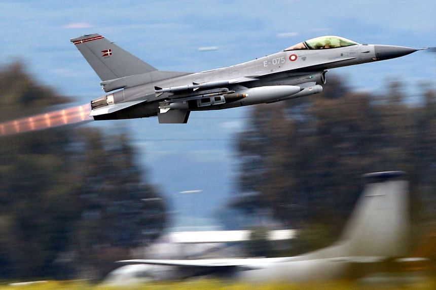 Danish F-16 jets have bombed the militants' stronghold city of Raqqa, targeting command and control facilities, weapons stocks and enemy personnel.