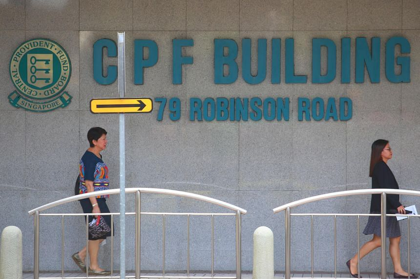 Pedestrians outside the CPF Building at 79 Robinson Road in Singapore.