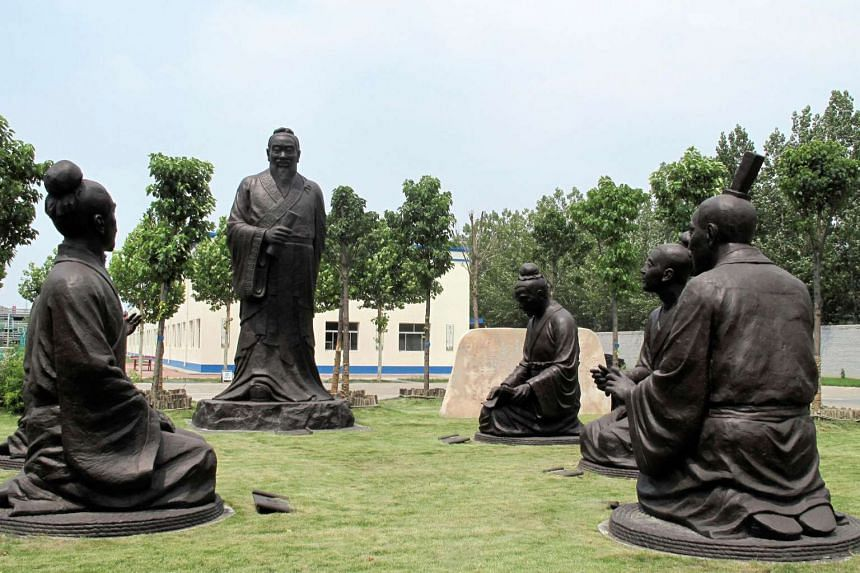 Sculptures of Confucius with his students are seen near the headquarters office building of Chambroad Holding in Boxing, Shandong Province, China, June 27.