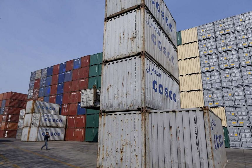 Containers from COSCO at a port in Shanghai, China, Feb 17, 2016.