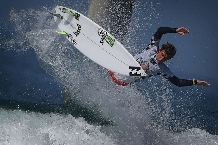 Griffin Colapinto of the US gets air before winning his men's heat during the first round of the US Open of Surfing at Huntington Beach, California on July 25, 2016.