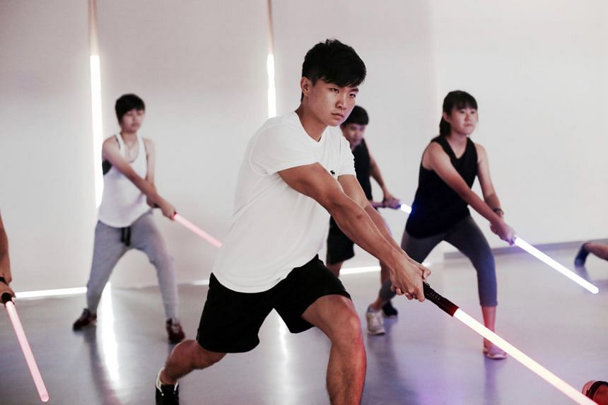 SaberFit is a new fitness class that uses combat sabers, which are glowing swords similar to the weapons found in the Star Wars films.