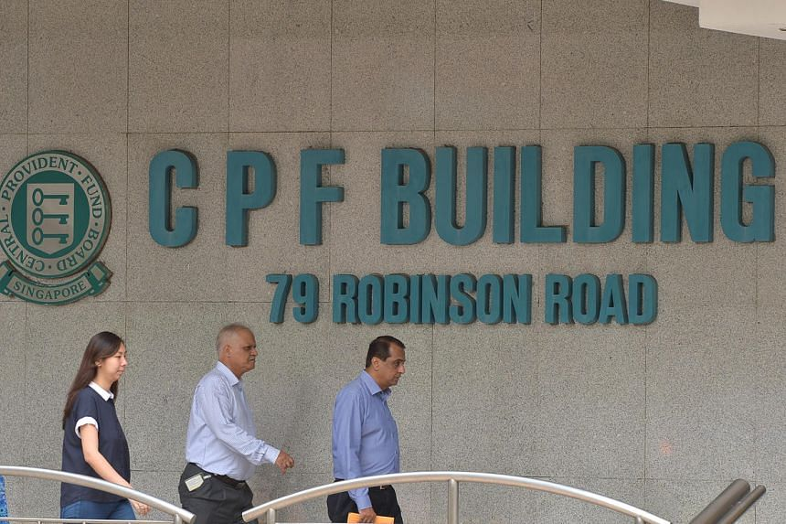 Office workers walking past CPF building in Robinson Road.