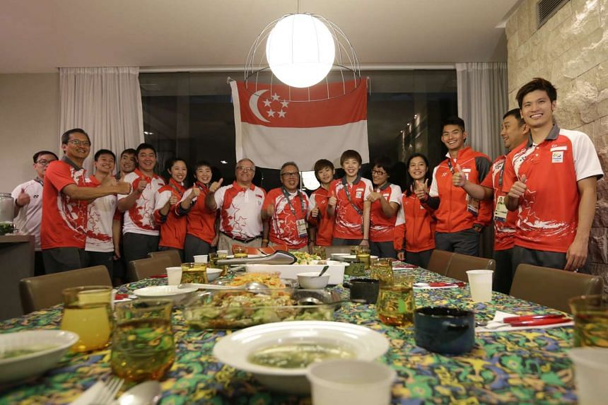 Team Singapore taking a group photo in the dining area of Singapore House on Aug 4, 2016.