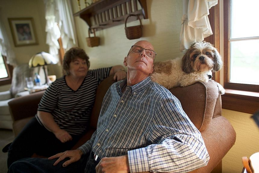 """Mr Ludwig with his wife and dog in May. He is now free of cancer, after having received cell therapy for chronic lymphocytic leukaemia in 2010. He and his wife are """"trying to make up for lost time"""", he said. Dr Rosenberg at the National Cancer Instit"""
