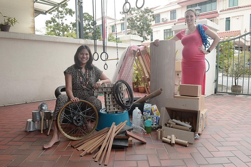 Chapter Zero Singapore co-founders Shumei Winstanley (left) and Kasia Poleszak- Langner with materials that will be found at the playground tomorrow.