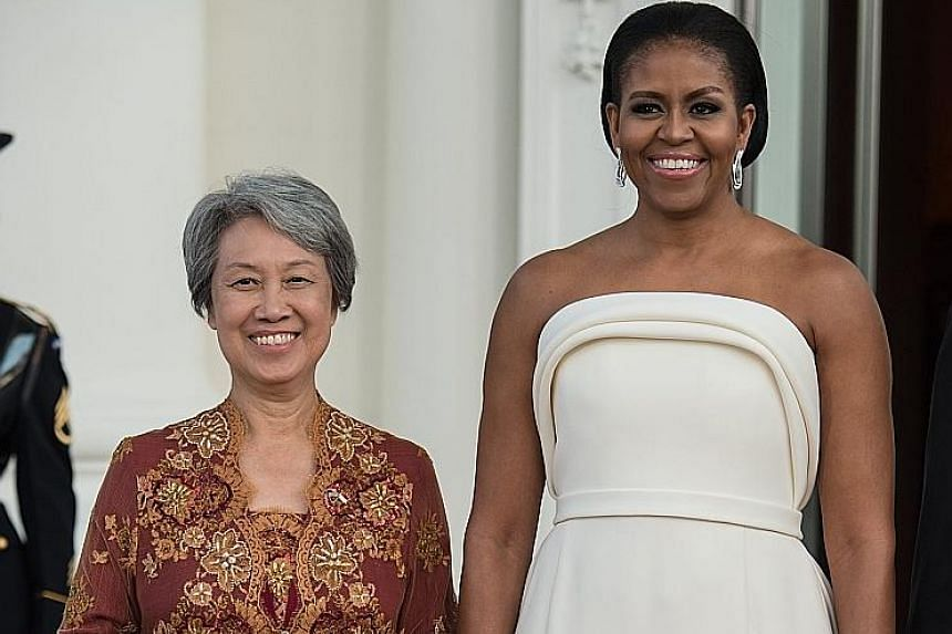 United States First Lady Michelle Obama with Ms Ho Ching, wife of Singapore Prime Minister Lee Hsien Loong, before the White House state dinner on Tuesday.