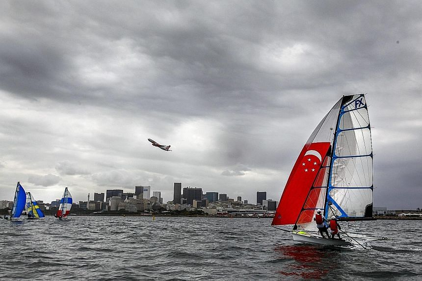 Sailors Sara Tan (left) and Griselda Khng from Singapore at a practice race on Wednesday in Rio's Guanabara Bay. Sailing events at the Games start on Monday.