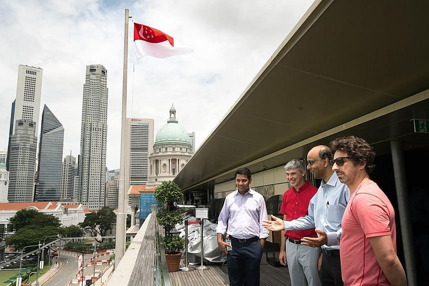 Mr Page (in red shirt) and Mr Brin (at right in picture) at the National Gallery with Mr Tharman. With them is Mr Caesar Sengupta (far left), vice-president of product management at Google.