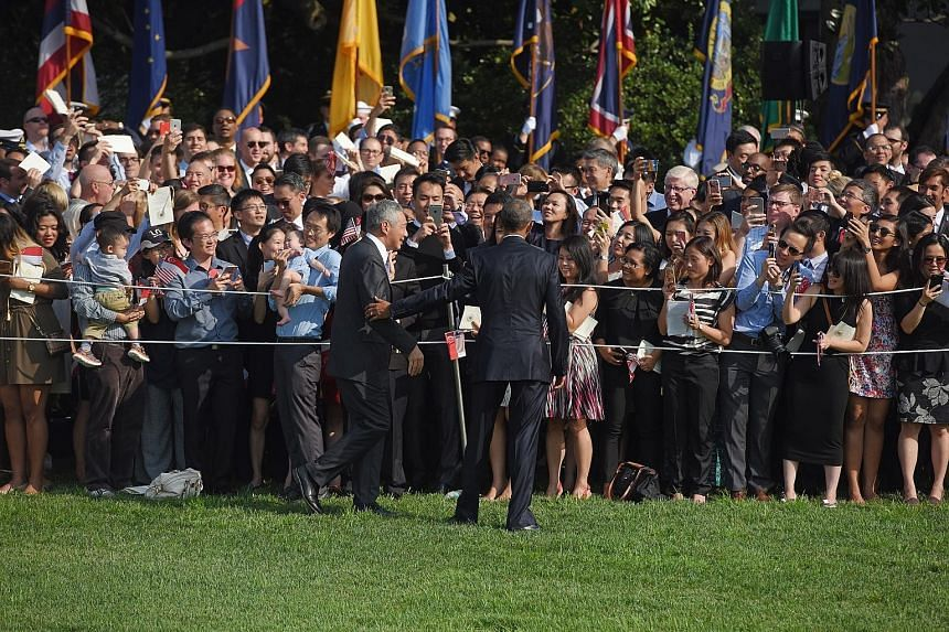 US President Obama and PM Lee meeting spectators gathered at the White House on Tuesday. Singapore was given a state dinner, one of the US government's highest diplomatic honours.
