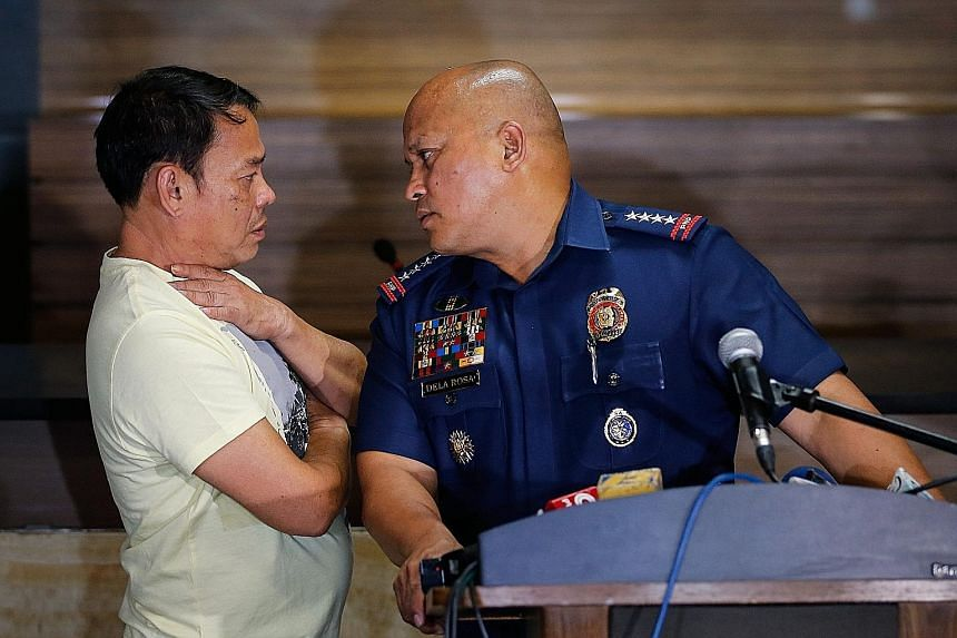 "Alleged drug lord Rolando Espinosa (left) with police chief Ronald dela Rosa, after surrendering on Tuesday. President Duterte threatened to have the former mayor ""shot on sight"". Suspected kingpin Rolando Espinosa claims that his son Kerwin (left),"
