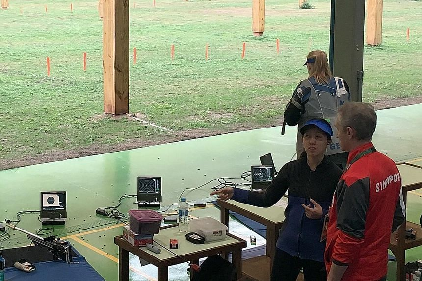 Jasmine Ser with her coach Kirill Ivanov during practice at the Olympic Shooting Centre in Rio de Janeiro on Wednesday. The second-time Olympian will skip the opening ceremony tonight so that she is ready to compete in he 10m air rifle event.