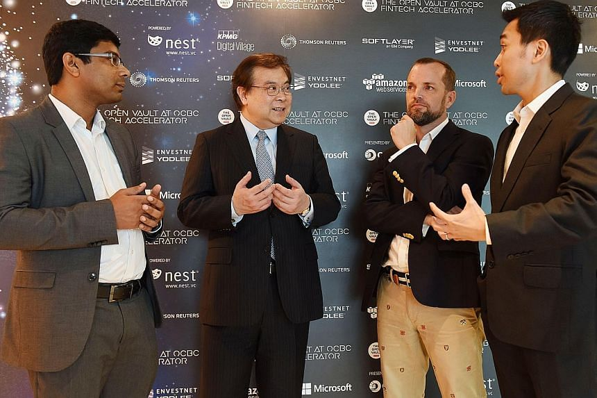 OCBC chief executive Samuel Tsien (second from left) with the founders of three collaborating fintech start-ups - (from left) Mr Rosh Cherian of CogniCor, Mr Andrew Connors of Fincast and Mr Donald Chan of BondIT. The start-ups will be conducting a t