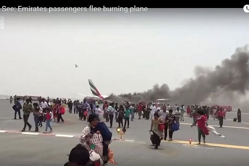 "Social media photos showed a plane lying crumpled on the tarmac with black smoke pouring from its upper section. Emirates chairman Ahmed Saeed Al Maktoum said the trouble with the flight was ""operational""."