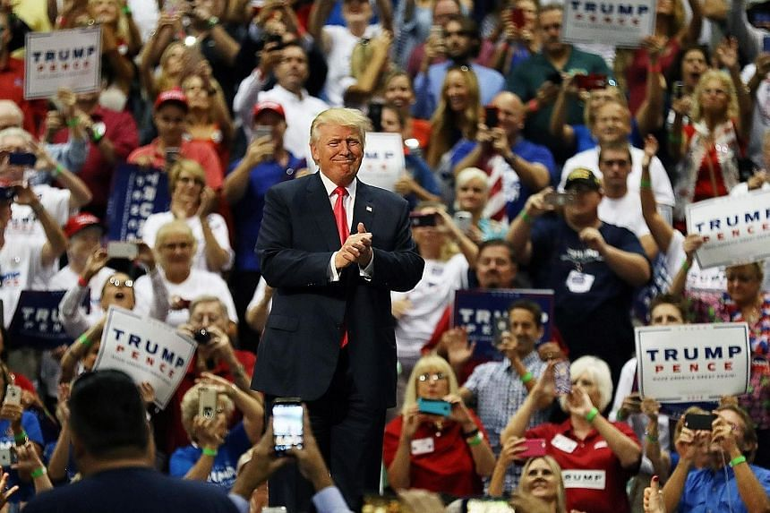 Mr Trump addressing the crowd on Wednesday in Daytona, Florida. With the surge in funds Mr Trump managed to raise from small donors, it suggests he may now have the resources to compete with Mrs Clinton in the closing stretch of the campaign.