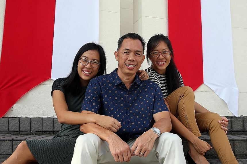 Among those given awards at the Home Team National Day Observance Ceremony yesterday were twins Adrienne (left) and Marienne, and their father Vincent Chew. They had saved their teenage neighbour from being strangled and robbed last November.