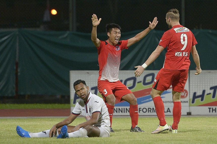 Song Ui Young (centre) celebrates his 65th-minute goal with his Home United team-mate Ken Ilso as a dejected Hafiz Osman of the Warriors looks on. The Protectors' duo accounted for all the goals in their 3-0 victory at Bishan Stadium yesterday.