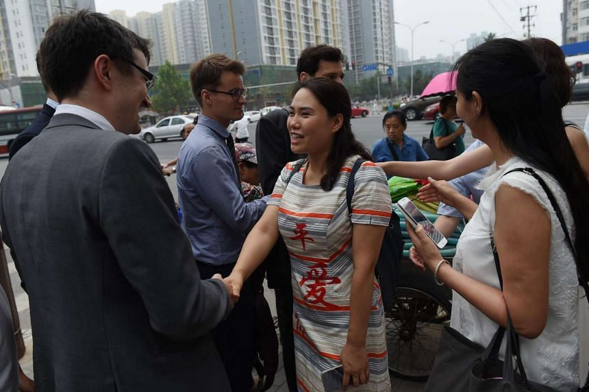 Fan Lili, wife of detained activist Gou Hongguo, meeting with foreign diplomats in Beijing on July 4.