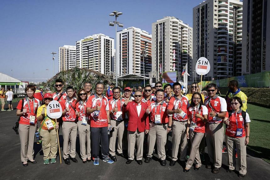 Chef de mission Low Teo Ping (centre, in red jacket) and some members of the 25-strong Singapore contingent at the Games Village in Rio de Janeiro, Brazil, after the welcome ceremony on August 2.