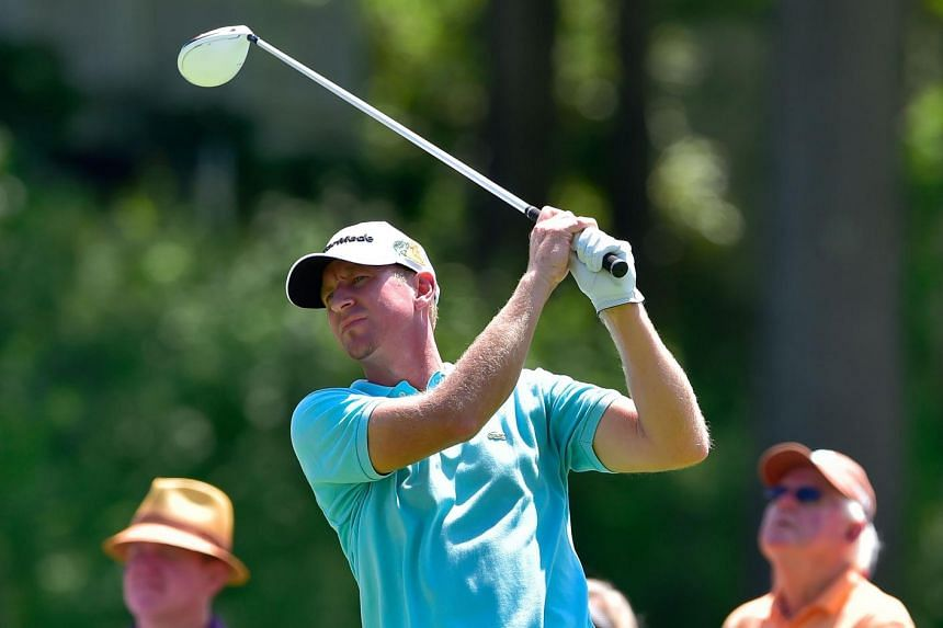 Vaughn Taylor of the United States plays his shot from the 18th tee during the first round of the travelers Championship at TPC River Highlands on Aug 4 in Cromwell, Connecticut.