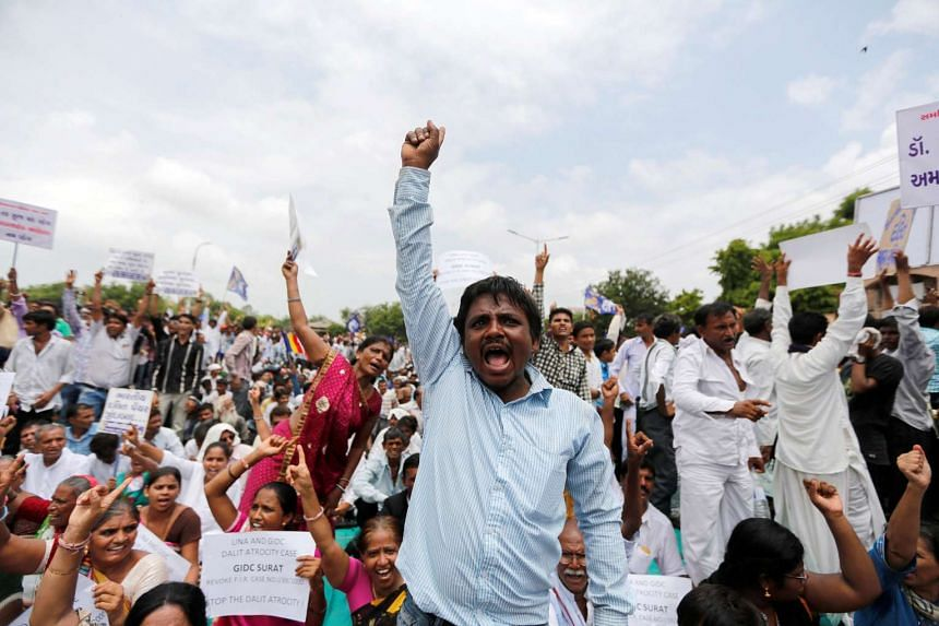 People attend a protest rally against what they say are attacks on India's low-caste Dalit community in Ahmedabad on July 31, 2016.