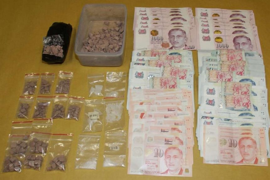 "Heroin, ""Ice"" and cash seized during CNB operation on Aug 4, 2016."