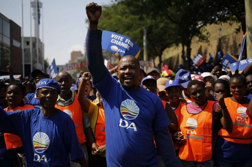 Democratic Alliance members march through the streets of downtown Johannesburg during a protest march against South African President Jacob Zuma on April 15, 2016.
