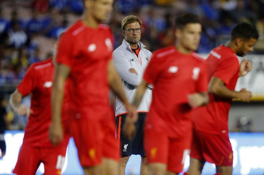Liverpool manager Juergen Klopp watches the players warm up.