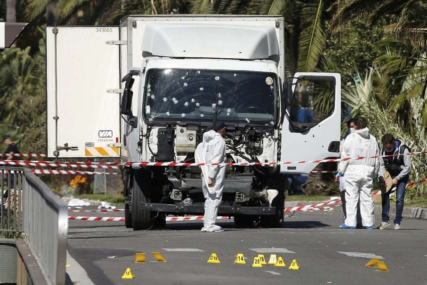 Investigators working on the truck driven by Tunisian-born Mohamed Lahouaiej Bouhlel.