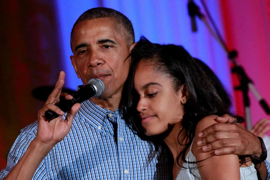 Obama congratulates his daughter Malia on her birthday during an Independence Day celebration at the White House, July 4, 2016.