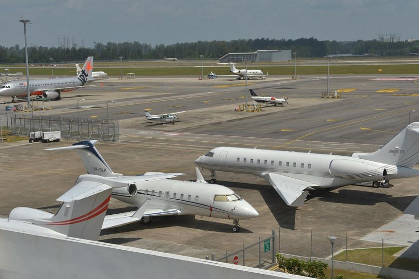 Aeroplanes on the Seletar Airport runway in Singapore.