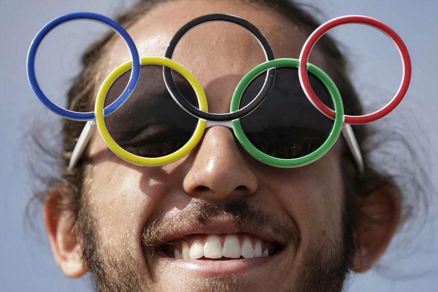 Games volunteer Andre Pacheco welcomes media and visitors to the Rio 2016 Olympics on Aug 4, 2016.