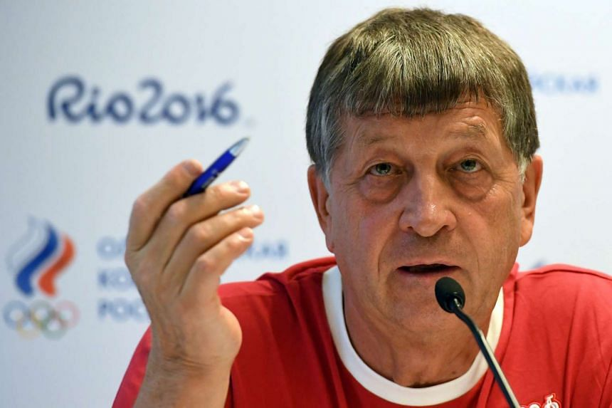 Igor Kazikov, head of Russia's Olympic delegation, attends a press conference at Copacabana beach on Aug 4.