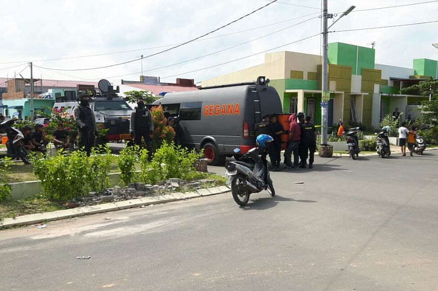 Police conduct raids at several places in Batam, including houses of suspected militants.