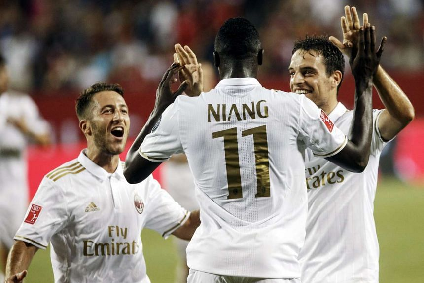 AC Milan players (from left) Andrea Bertolucci, M'baye Niang and Giacomo Bonaventura celebrate a goal.