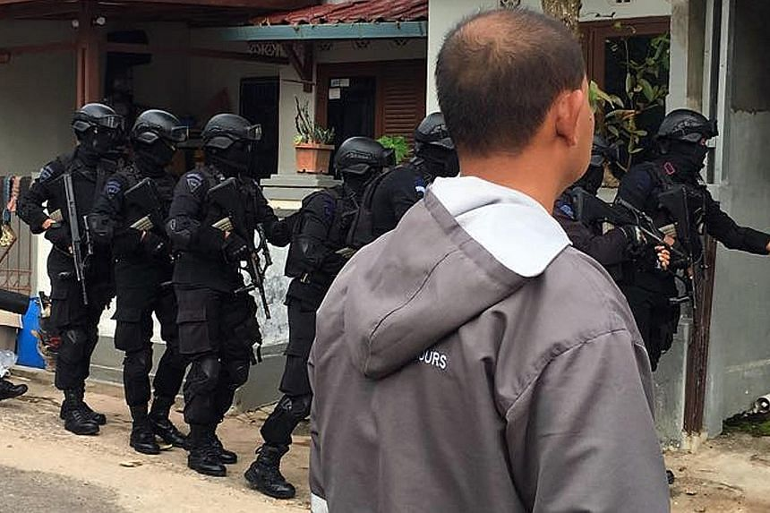 Indonesia's elite counter- terrorism unit Densus 88 carrying out a raid in Batam. Six members of a little-known terror cell called Katibah GR, or Cell GR, were arrested yesterday.