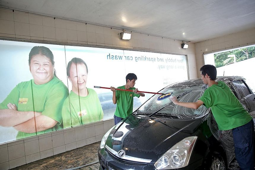 Minds Wash, a car wash operated by the Movement for the Intellectually Disabled of Singapore. There have been more office jobs for people with disabilities in recent years, but associations say a large portion of jobs are entry-level, manual roles.