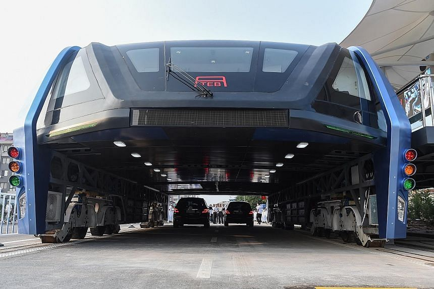The first test run of the bus, which arcs over two lanes of traffic, was carried out on Tuesday in Qinhuangdao. Questions were asked about how it would turn; its 2m clearance which is too low for large vehicles; and how it would deal with drivers cha
