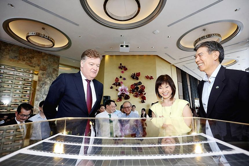 From left: CDL CEO Grant Kelley, Senior Minister of State for the Environment and Water Resources and Health Amy Khor and SEAS chairman Edwin Khew viewing a model of the Singapore Sustainability Academy. It will open in March, have 300 sq m of solar