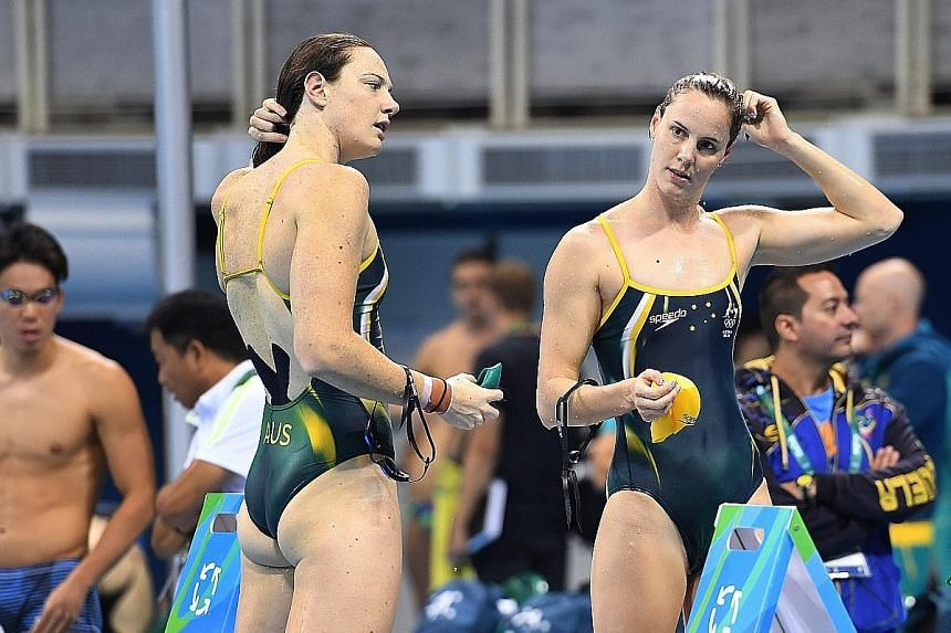 Cate Campbell (far left) and younger sister Bronte during the Australian team's first training session in Rio on Monday.
