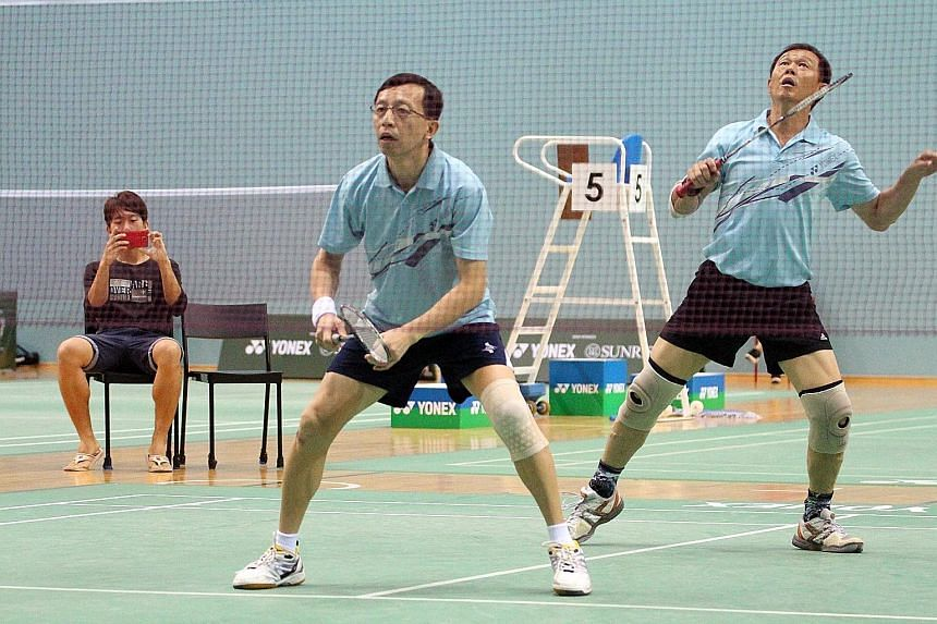 Brothers Yap Wee Teck (left) and Yap Wee Jin will defend their badminton men's doubles title at the Singapore National Games. Communication has been key to their success.
