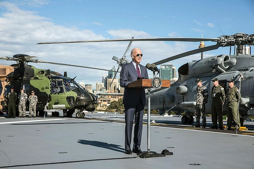 US Vice-President Joe Biden speaking to Australian Defence Force personnel on board the HMAS Adelaide at a naval base in Sydney last month. The two allies cannot agree on who will bear the costs of housing and utilities like power and sewerage for th
