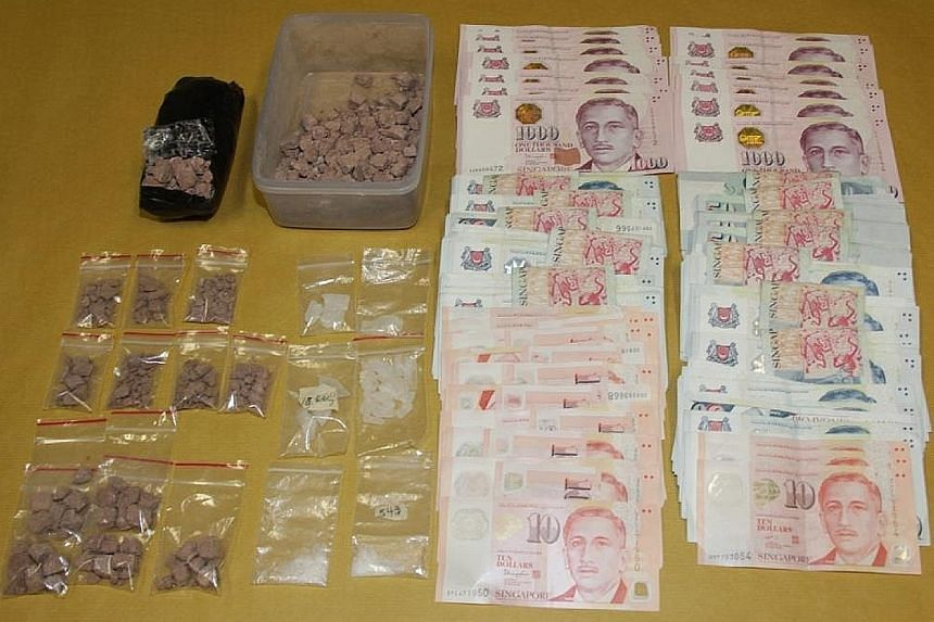 Heroin, Ice and cash seized on Thursday, when CNB officers arrested three suspected drug offenders and seized about 620g of heroin and 40g of Ice, with an estimated street value of more than $48,000.