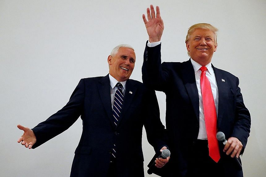 Mr Trump (right), here with his running mate Mike Pence, is facing urgent calls to stabilise his candidacy and declining poll numbers.
