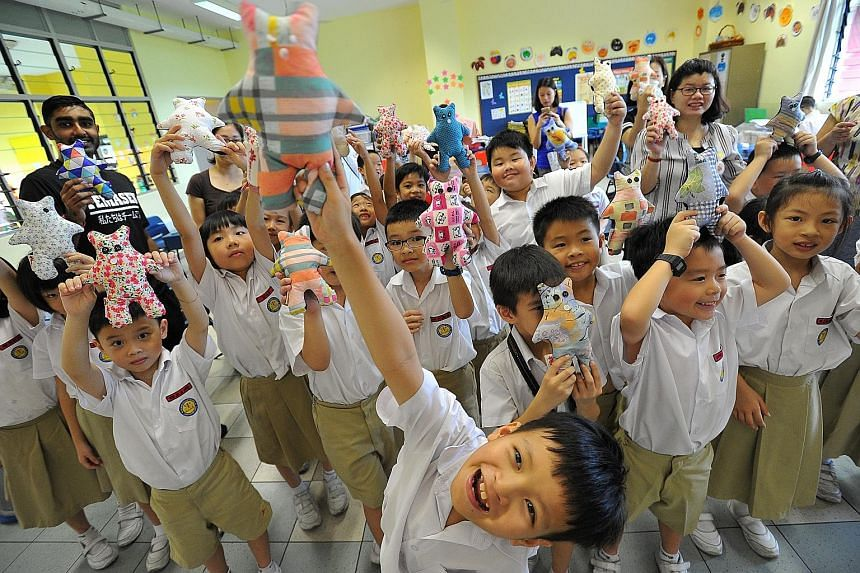 Pupils of Yu Neng Primary School with the bears they made yesterday. In all, 1,400 pupils, staff and parent volunteers made some 1,600 bears for charity.