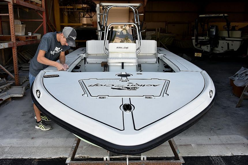 A craft boat manufacturing facility in the US. Manufacturing sector employment increased by 9,000 jobs last month after adding 15,000 positions in June.