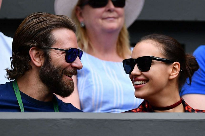 Cooper and Russian model Irina Shayk watch the Wimbledon tennis tournament in London on July 8, 2016.