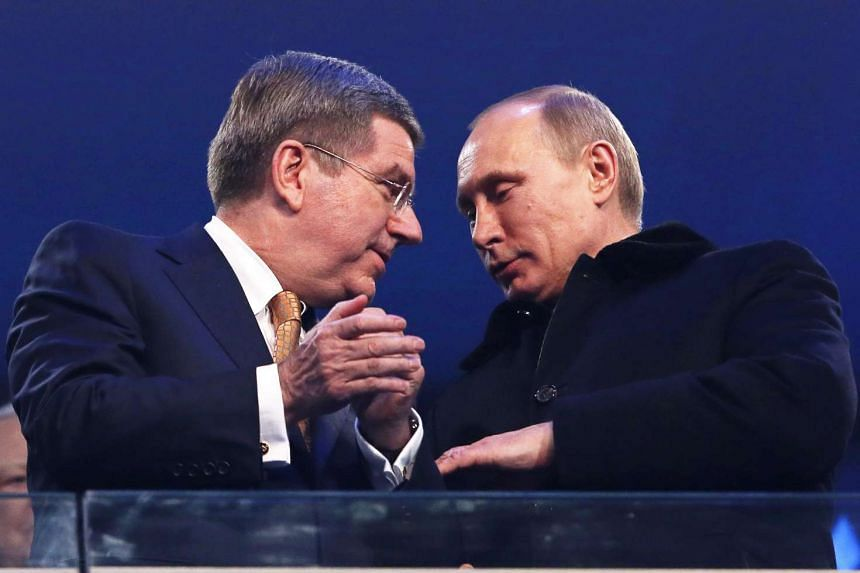 IOC president Thomas Bach (left) with Russian President Vladimir Putin during the Opening Ceremony for the Sochi 2014 Olympic Games.
