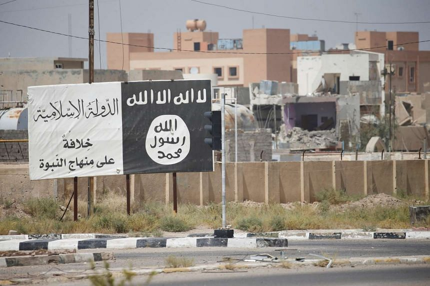 The flag of ISIS militants is seen in Falluja, Iraq, June 25, 2016.
